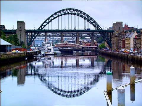 montage of bridges including gateshead millennium bridge tyne bridge trinity bridge westminster bridge and hungerford bridge - tyne bridge stock videos & royalty-free footage