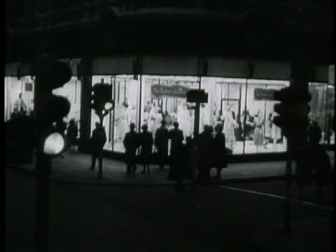 montage of bustling city life in 1945 london. - film montage stock videos & royalty-free footage