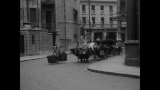 a montage of busy street scenes at the bund (waterfront area) by the huanpu river. men carry large loads on their backs. carriages are shown. - naga river stock videos and b-roll footage