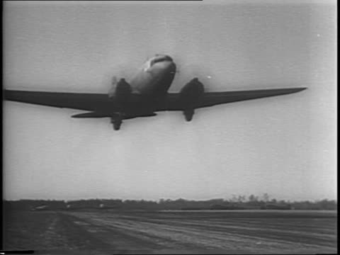 montage of c47 transport planes taking off c47 planes flying in formation / montage of paratroopers inside transport plane lighting up cigarettes... - fallschirmjäger stock-videos und b-roll-filmmaterial