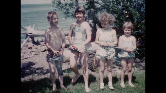 montage of children with fishing poles and nest getting ready to fish. - nackter oberkörper stock-videos und b-roll-filmmaterial