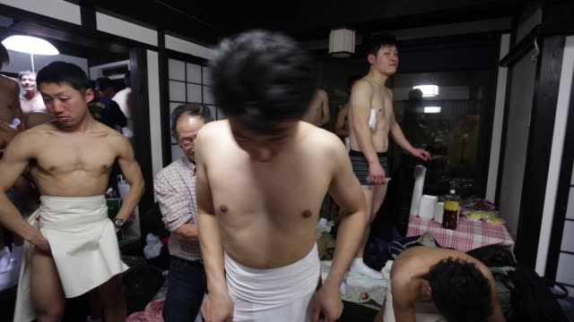 Montage of clips of the Hadaka Matsuri or Naked Man Festival at Saidaiji Temple on February 21 2015 in Okayama Japan Some 9000 men battle to grab a...