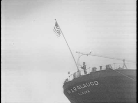 Montage of Coast Guard boarding the German tanker 'Pauline Friederich' / montage of seamen entering an immigration detention center in Gloucester NJ...