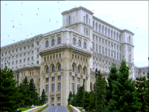 montage of exteriors of ceaucescu's palace world's second biggest building bucharest - romania stock videos & royalty-free footage