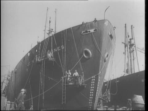Montage of factory war production / montage of war wreckage / montage of ships being loaded / stacks of containers that read 'Chevrolet' / Admiral...