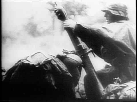 montage of firing cannons german soldier loading rocket mortars exploding street lined with destroyed allied vehicles burning wreckage of town woman... - carrying stock videos & royalty-free footage