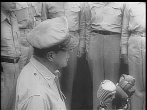 montage of general douglas macarthur giving speech press snapping pictures japanese listening to speech - japanese surrender stock videos & royalty-free footage