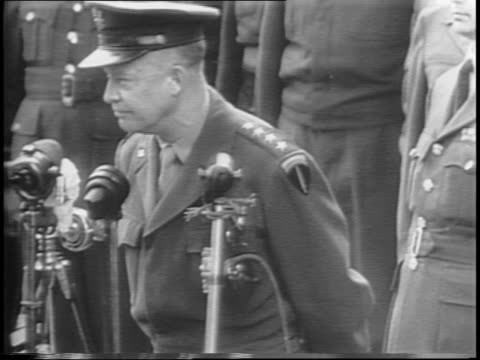 montage of general dwight d eisenhower in paris motorcade cheering waving onlookers eisenhower at arc de triomphe giving speech - anno 1944 video stock e b–roll