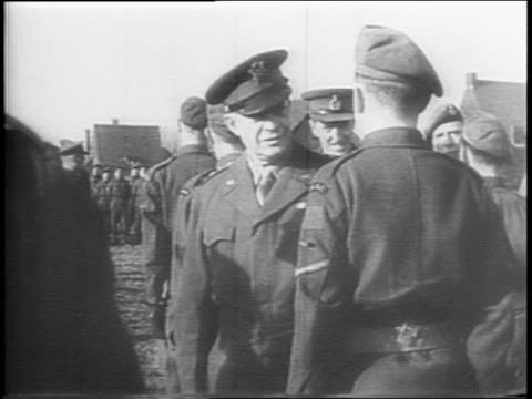 montage of general dwight eisenhower inspecting troops of the british 2nd army troops saluting - anno 1944 video stock e b–roll
