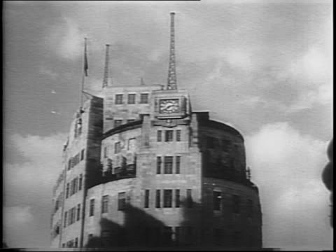 montage of houses of parliament big ben from thames / clocktower with antennae - anno 1944 video stock e b–roll