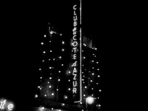montage of illuminated signs for restaurants, cafes and bars in soho. 1956. - 1950 stock videos & royalty-free footage