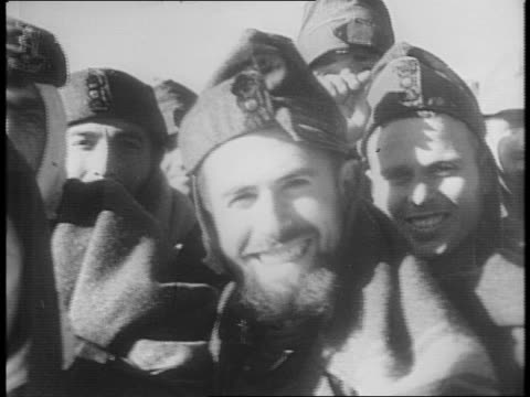 montage of italian prisoners marching through the desert, in barbed wire pen guarded by british soldiers, taking cigarettes / aerial footage of... - 1941 stock-videos und b-roll-filmmaterial