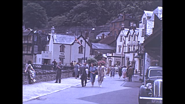 a montage of lynmouth shot in colour in 1950 shortly before a disasterous flood destroyed much of the village includes a standard flying 12 car and... - film montage stock videos & royalty-free footage