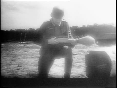 montage of nazi soldier loading and firing a bazooka, four tanks launching rockets, multiple explosions from rockets in a field, fortifications... - weaponry stock videos & royalty-free footage