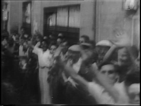 montage of nazi soldier prisoners of war in southern france / allied troops riding on top of tank and passing by newly freed french citizens,... - prisoner video stock e b–roll