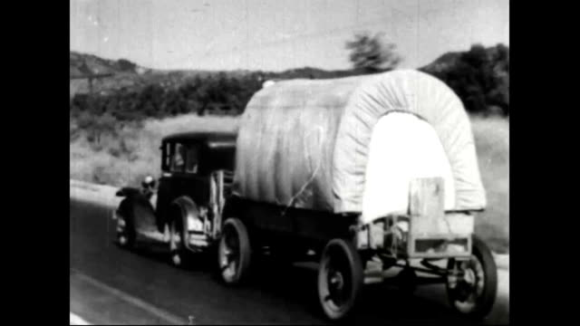 montage of people migrating west during the dust bowl - animal migration stock videos & royalty-free footage