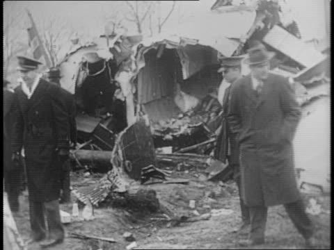montage of plane wreckage damaged trees stewardess convalescing in bed wreckage being inspected - saint louis bildbanksvideor och videomaterial från bakom kulisserna