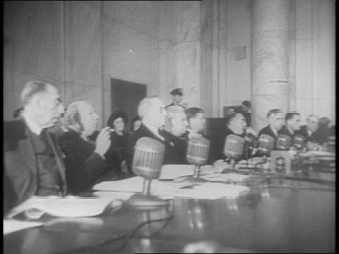 vídeos y material grabado en eventos de stock de montage of proceedings at senate foreign relations committee meeting / includes secretary of state cordell hull at table - senador