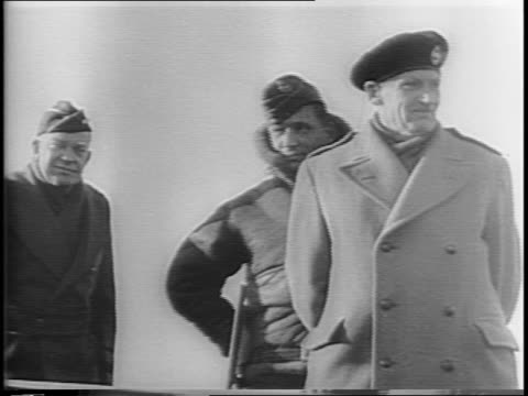 Montage of RAF Marshall Arthur Tedder General Dwight D Eisenhower and Field Marshall Bernard Montgomery standing atop a tank as reporters snap photos...