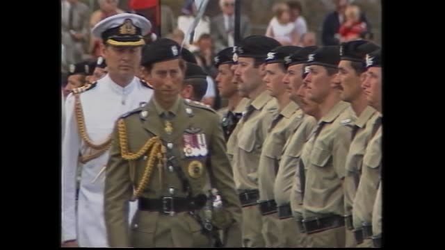 Montage of Royal tour events Band plays national anthem– Prince Charles and Princess Diana watch / royals meeting army soldiers / Diana with flowers...