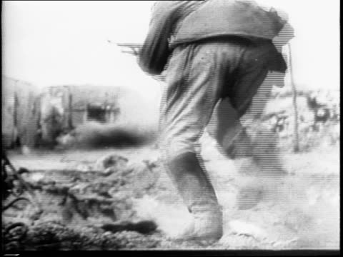 montage of russian soldiers running through streets and rubble under fire and smoke / one captures a small machine gun. - 1942 stock videos & royalty-free footage