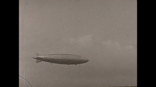 a montage of shots from the 1930 airforce pagaent airshow of 1930 featuring the r101 airship this amateur footage shows crowd scenes of visitors... - air force stock videos & royalty-free footage