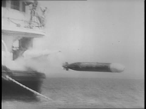 montage of shots of torpedoes being launched from barge, moving through water. - barge stock videos & royalty-free footage
