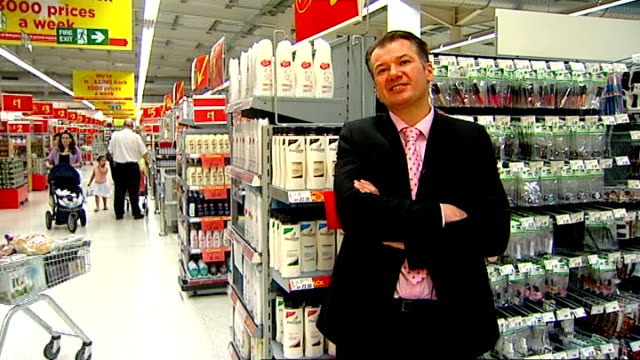 Montage of signs on supermarket shelves for cut price food offers Reporter to camera SPEEDEDUP shot of customers browsing milk aisle in supermarket...