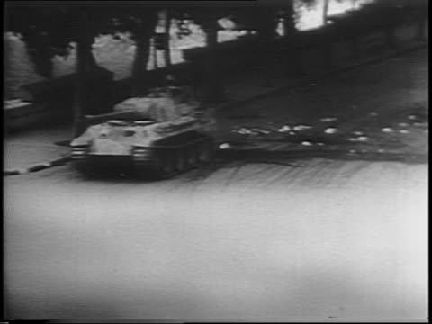 montage of smoke rising over paris buildings / civilians in foreground watching smoke rising in background / nazi tank rolls down street / cars... - wochenschau stock-videos und b-roll-filmmaterial
