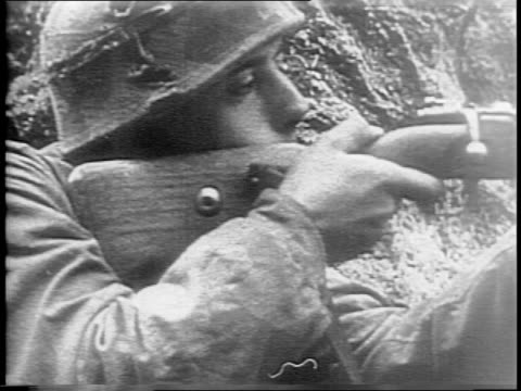 montage of soldiers advancing by vehicle and on foot, explosions in a field, soldiers in trenches with camouflaged helmets, soldier crawling through... - gun stock videos & royalty-free footage