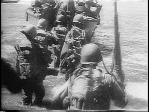 montage of soldiers invading wading into ocean military ships / map of south pacific arrow pointing to palau - south pacific ocean stock videos & royalty-free footage