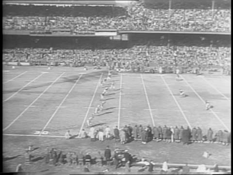 montage of stands full of people, onlookers seated at sidelines, opening kickoff and game play . - nfc east stock videos & royalty-free footage