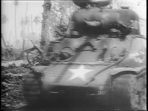 vídeos de stock, filmes e b-roll de montage of tanks advancing through jungle / montage showing casualties on ground / montage of an american soldier being wrapped with a bandage around... - atol