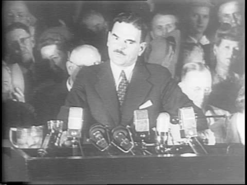 stockvideo's en b-roll-footage met montage of thomas dewey speaking applauding crowd shaking hands with several people at conclusion - political action committee