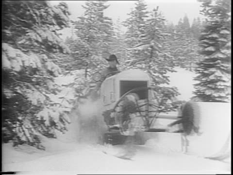 montage of two men driving through snow on a 'snowcat' pulling a sled closeup on 'snowcat' track wheels shot from sled being pulled by 'snowcat'... - uneven stock videos & royalty-free footage