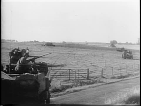 montage of us army advancing on siegfried line damage to defenses towns general courtney hodges meeting with archbishop francis spellman - anno 1944 video stock e b–roll