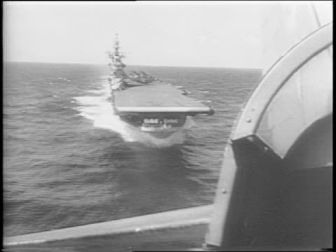 Montage of US destroyers and US aircraft carriers out at sea Admirals Chester Nimitz William Halsey and Thomas C Kinkaid USS Iowa firing off cannons...