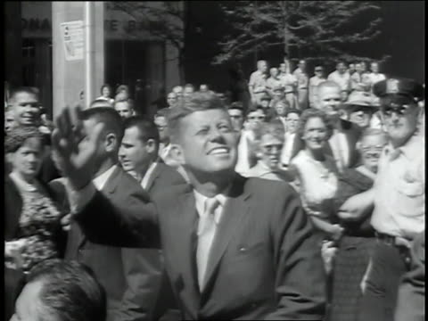 a montage of u.s. president john f. kennedy features a presidential motorcade and public appearances with his wife jacqueline kennedy in a tribute to the u.s. president following his assassination. - john f. kennedy us president stock videos & royalty-free footage