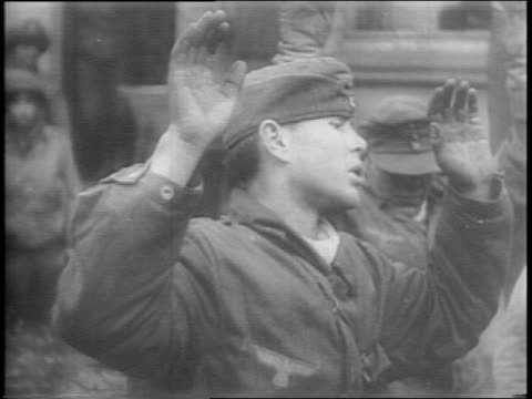 montage of us troops holding guns on german pows german major general franz vaterrodt captured with 5000 of his men pows standing huddled in a large... - anno 1944 video stock e b–roll