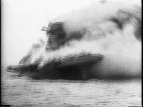 montage of uss lexington burning and exploding after the battle of the coral sea / crowd of men taking navy oath before an officer / wayne patten... - battle stock videos & royalty-free footage