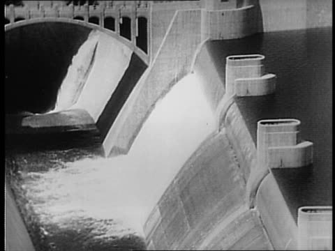 montage of views of boulder dam / a hand pulls a level / the needle of a dial wiggles / water discharges over the top of the dam's spillway / montage... - clark county nevada stock videos & royalty-free footage