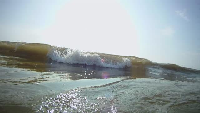 cu montage of waves crashing offshore / st. peter-ording, schleswig holstein, germany  - schleswig holstein stock-videos und b-roll-filmmaterial