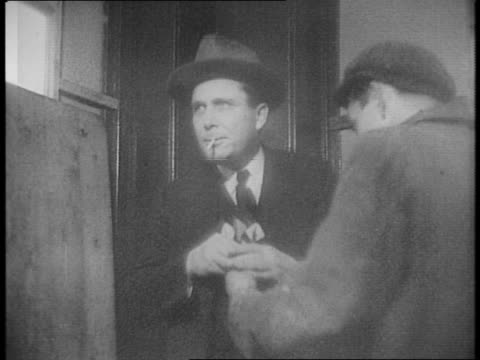 montage of wendell willkie exiting car, entering pub / willkie drafts a beer inside the pub / montage of willkie as he throws darts with a local. - ダーツバー点の映像素材/bロール