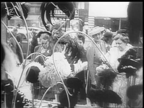 montage of women looking at hats in a store display window / women shop in a hat store / milliners steam hats - milliner stock videos and b-roll footage