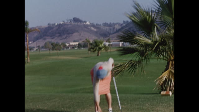 stockvideo's en b-roll-footage met montage of women playing golf in palm springs. - golf sport