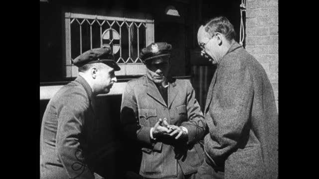 vídeos de stock e filmes b-roll de montage of writer joseph furnas interviewing nurses police doctors state policemen joseph furnas typing on typewriter - 1935