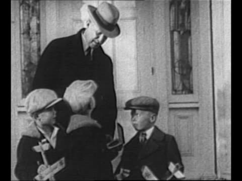 vídeos de stock, filmes e b-roll de montage orville wright with three young boys who hold model gliders and his aero club of america medal which he received from us president william... - orville wright