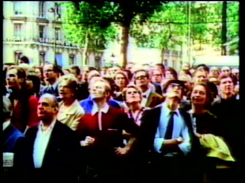 montage, people from around the world watching the apollo 11 moon landing on public televisions. - moon stock videos & royalty-free footage