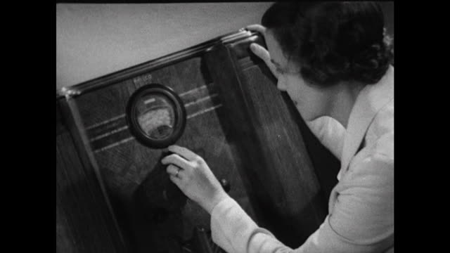 montage: people tuning radios in 1937 - black and white stock videos & royalty-free footage