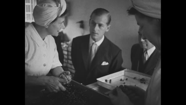 montage philip duke of edinburgh talks to women preparing fruit in factory all smile duke walks away woman breathes sigh of relief - 1949 stock videos and b-roll footage